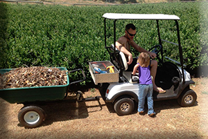 Me and my Dad, with the Farm-Mate Electric utility cart